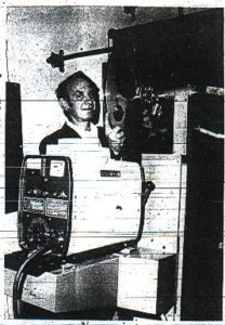 Bill Ramsey with new theater projector Photo courtesy Golden Transcript, 1972